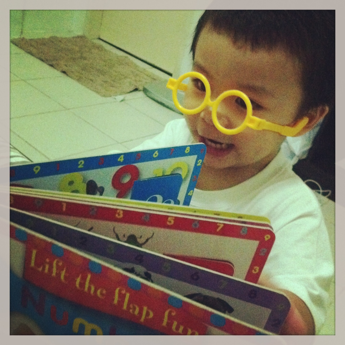 read his favorite books.. may props pa na eyeglass...